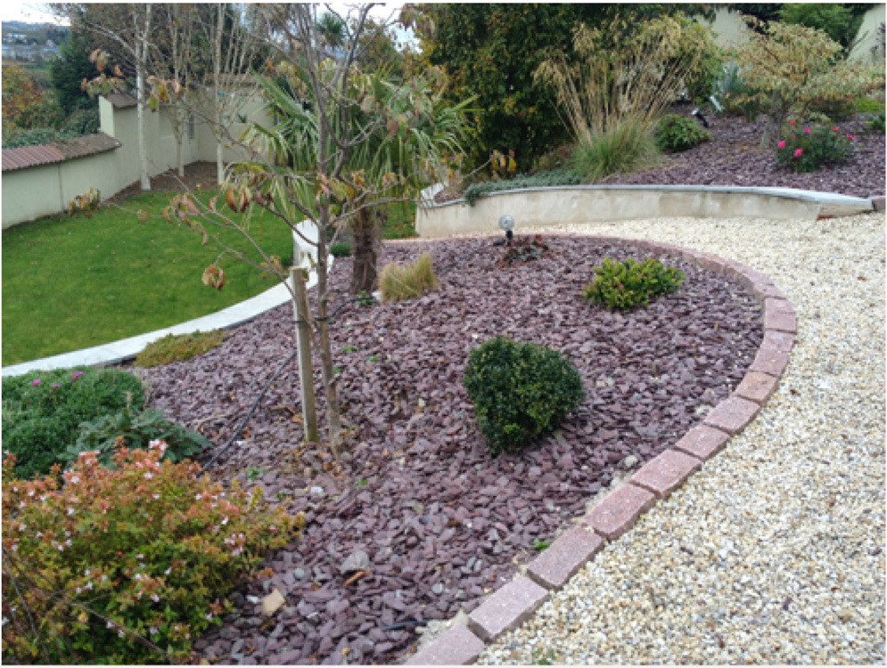 Plum Slate Mulch used in sloping garden design